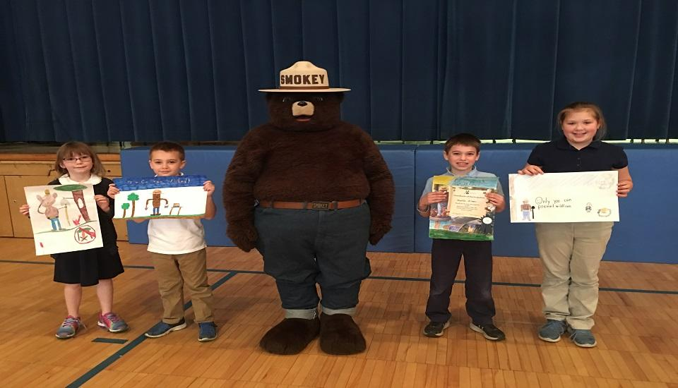 First Place poster Contest winners with Smokey Bear